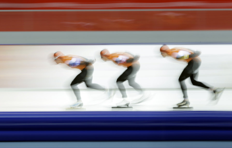 Photo - Speedskaters from the Netherlands Koen Verweij, Jan Blokhuijsen and Sven Kramer, from left to right compete in the men's speedskating team pursuit semifinals at the Adler Arena Skating Center at the 2014 Winter Olympics, Friday, Feb. 21, 2014, in Sochi, Russia. (AP Photo/Matt Dunham)