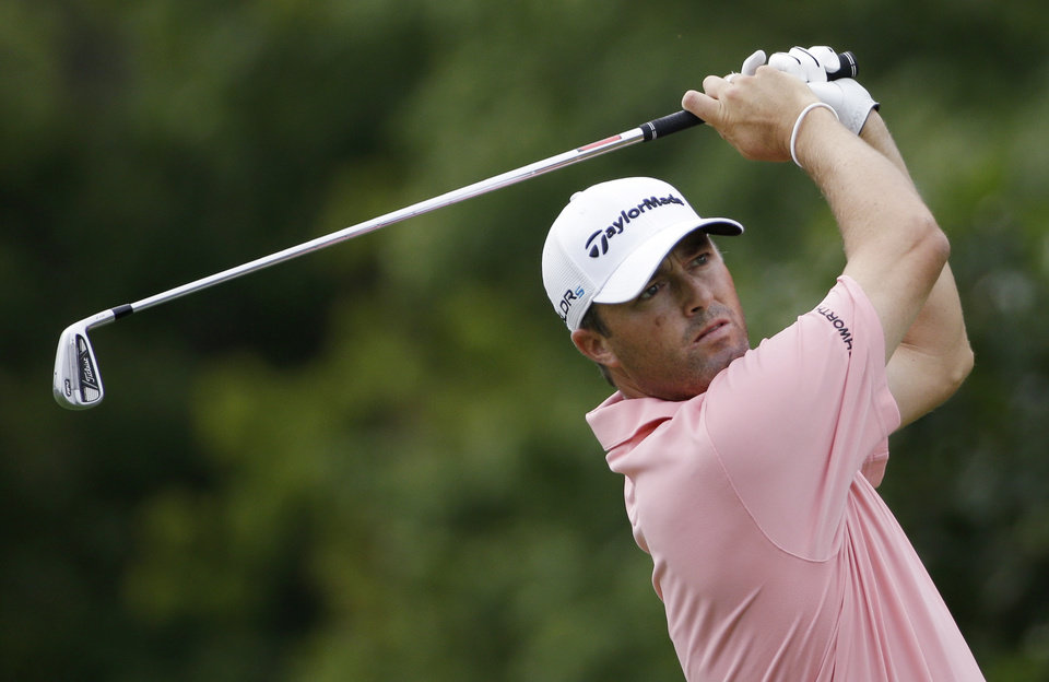 Photo - Ryan Palmer watches his tee shot on the eighth hole during the first round of the PGA Championship golf tournament at Valhalla Golf Club on Thursday, Aug. 7, 2014, in Louisville, Ky. (AP Photo/David J. Phillip)