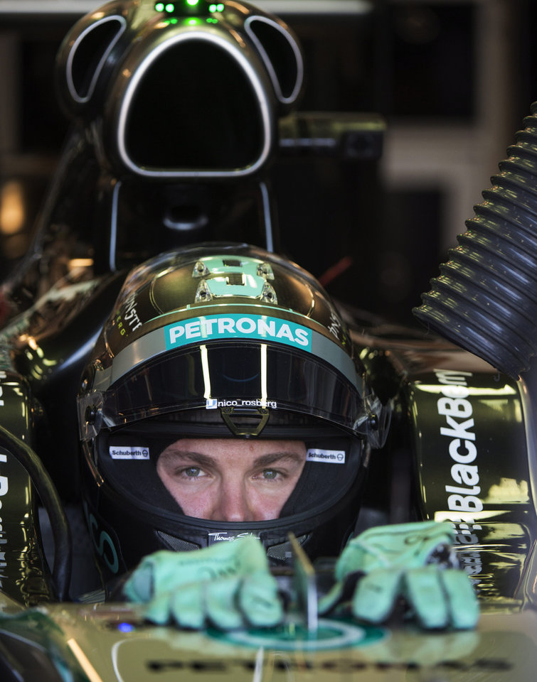 Photo - Mercedes driver Nico Rosberg from Germany sits in his car during the third practice session at the Canadian Grand Prix Saturday, June 7, 2014 in Montreal.  (AP Photo/The Canadian Press, Paul Chiasson)