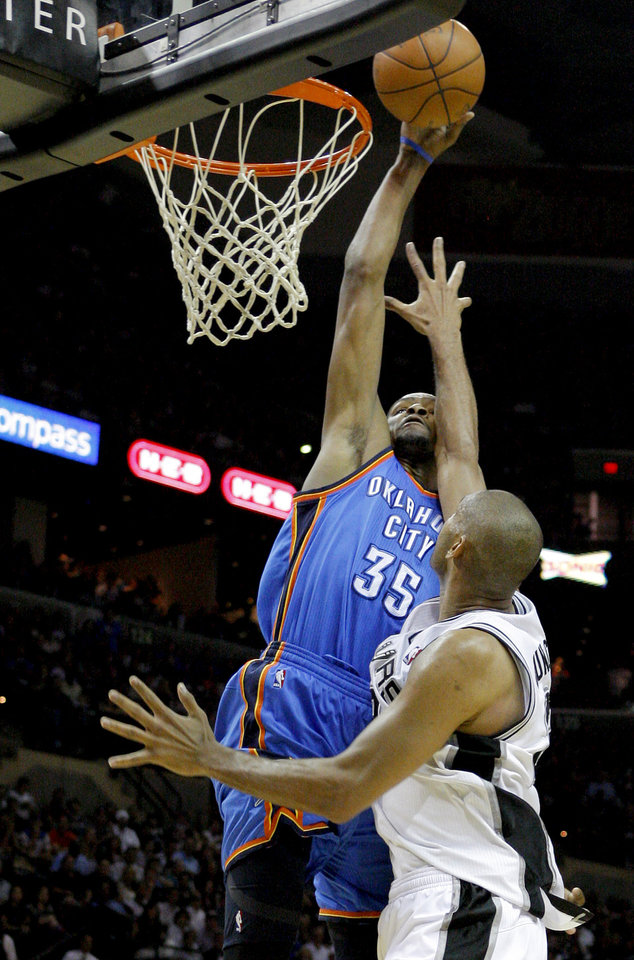 Oklahoma City\'s Kevin Durant (35) can\'t get past San Antonio\'s Tim Duncan (21) during Game 1 of the Western Conference Finals between the Oklahoma City Thunder and the San Antonio Spurs in the NBA playoffs at the AT&T Center in San Antonio, Texas, Sunday, May 27, 2012. Oklahoma City lost 101-98. Photo by Bryan Terry, The Oklahoman