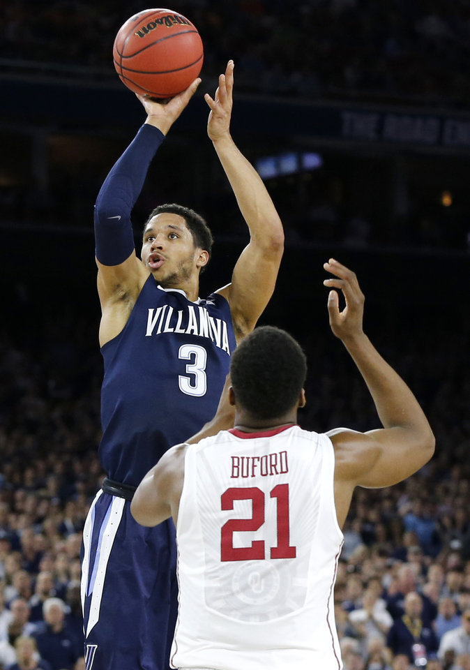 Photo - Villanova's Josh Hart (3) shoots over Oklahoma's Dante Buford (21) during the national semifinal between the Oklahoma Sooners (OU) and the Villanova Wildcats in the Final Four of the NCAA Men's Basketball Championship at NRG Stadium in Houston, Saturday, April 2, 2016. Photo by Nate Billings, The Oklahoman