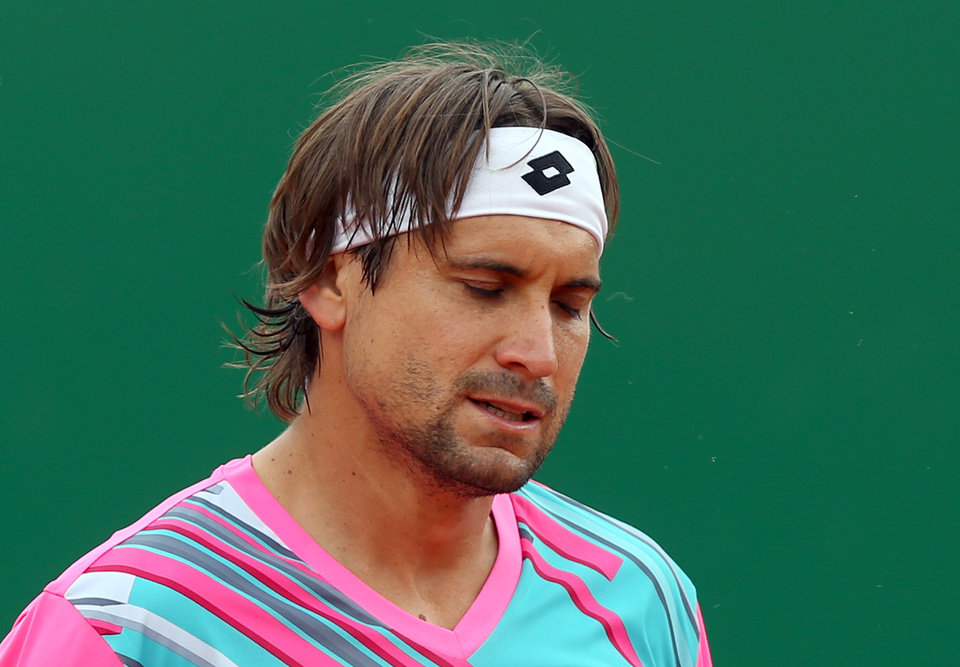 Photo - David Ferrer of Spain loses a point to Stanislas Wawrinka of Switzerland during their semifinal match of the Monte Carlo Tennis Masters tournament in Monaco, Saturday April 19, 2014. Wawrinka won 6-1, 7-6. (AP Photo/Claude Paris)