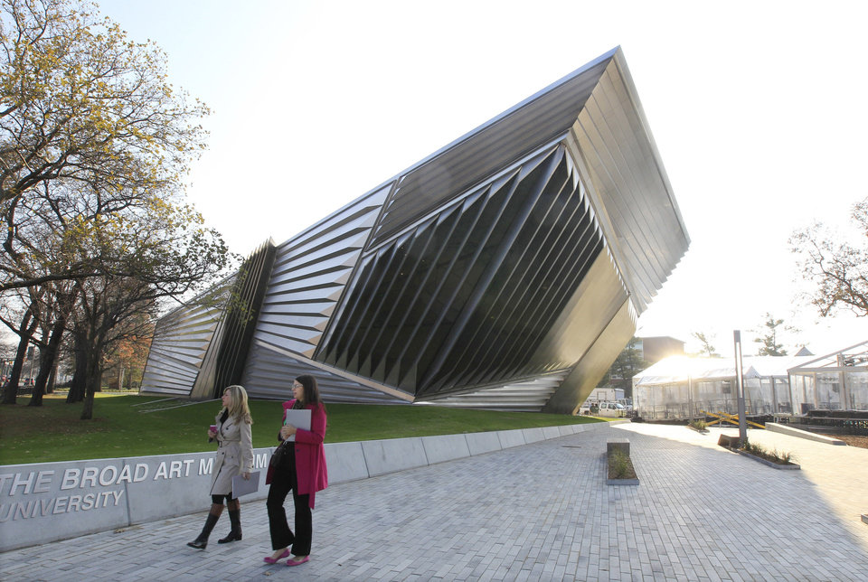 In this Nov. 9, 2012 photo the exterior of the Eli and Edythe Broad Art Museum is seen on the campus of Michigan State University in East Lansing, Mich. The museum features Zaha Hadid's signature look: a facade of pleated stainless steel and glass, which distinguishes it from the traditional brick Collegiate Gothic buildings that surround it on Michigan State's north campus. (AP Photo/Carlos Osorio)