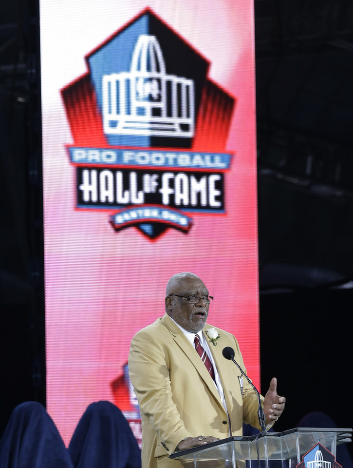Photo - Hall of Fame inductee Claude Humphrey speaks during the Pro Football Hall of Fame enshrinement ceremony Saturday, Aug. 2, 2014, in Canton, Ohio. (AP Photo/Tony Dejak)