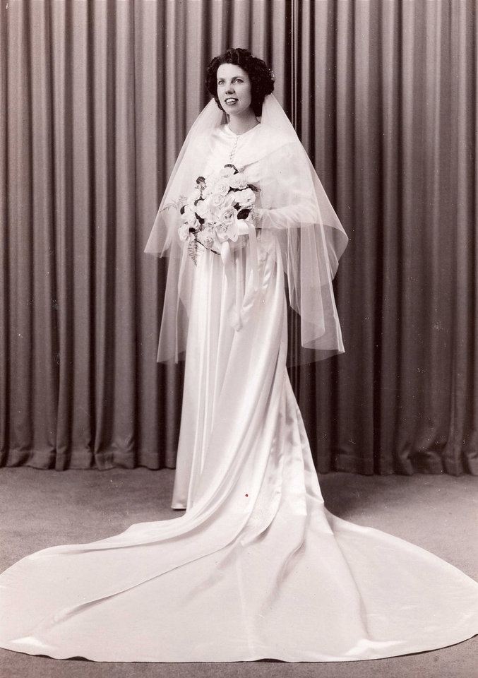 Photo - The '40s were all about keeping things simple and clean. Eunice Moir Passig married her husband Dec. 28, 1948, in a heavy satin dress with a long train and lace overlay on the bodice, said Carolyn Passig Jensen, Passig's daughter. Photo provided by Carolyn Jensen.  PROVIDED