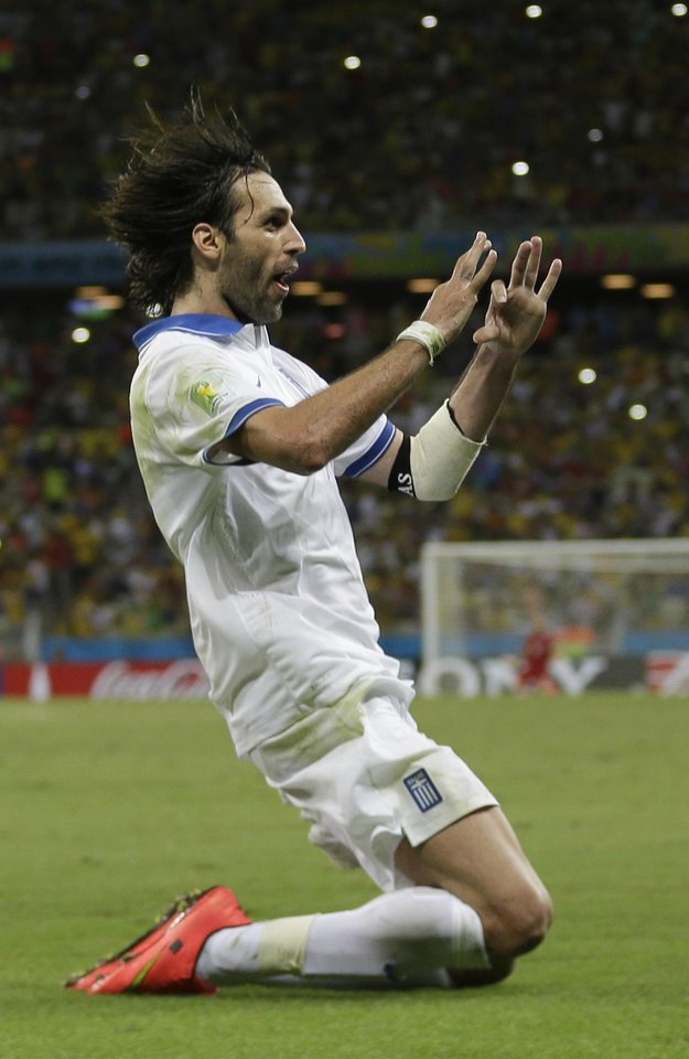 Photo - Greece's Giorgos Samaras celebrates scoring his side's second goal during the group C World Cup soccer match between Greece and Ivory Coast at the Arena Castelao in Fortaleza, Brazil, Tuesday, June 24, 2014. (AP Photo/Natacha Pisarenko)