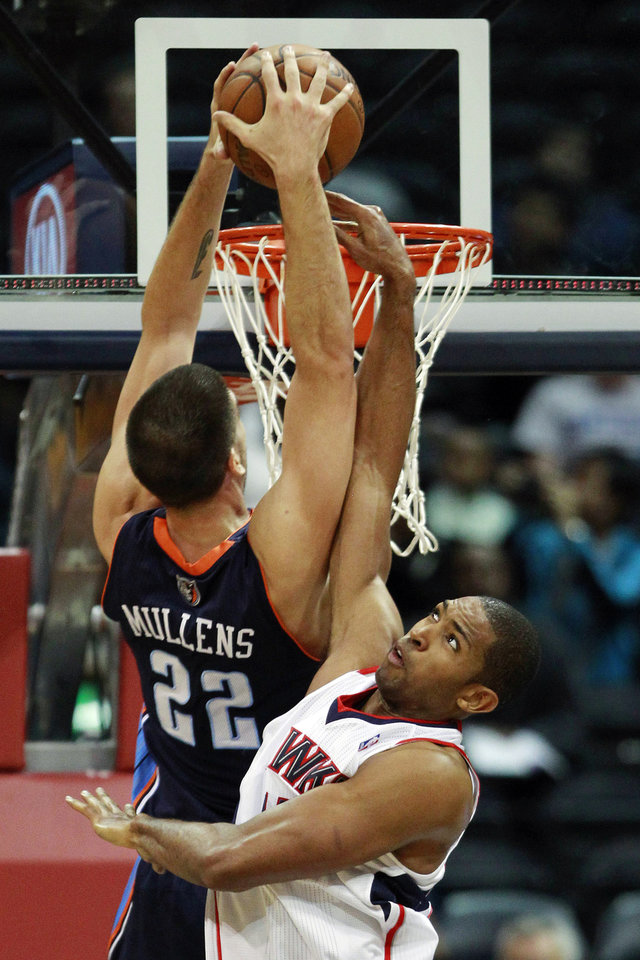 Charlotte Bobcats center Byron Mullens (22) goes to the basket as Atlanta Hawks\' Al Horford defends in the first half of an NBA basketball game, Wednesday, Nov. 28, 2012, in Atlanta. (AP Photo/John Bazemore)