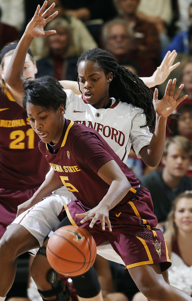 Photo - Arizona State guard Deja Mann (5) works against Stanford guard Lili Thompson during the first half of an NCAA college basketball game Friday, Feb. 14, 2014, in Stanford, Calif. (AP Photo/Marcio Jose Sanchez)