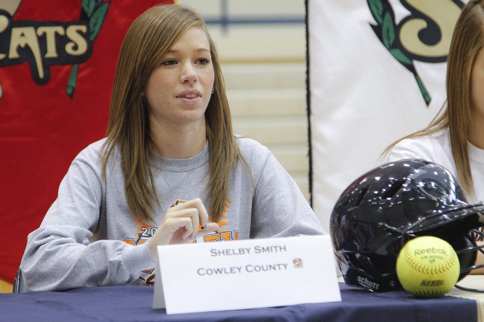 Photo - NATIONAL SIGNING DAY / SIGN / SIGNED: Southmoore High School's Shelby Smith sits at a table after signing her letter of intent to play softball at Cowley County during National Signing Day at Southmoore High School on Wednesday, Feb. 1, 2012, in Oklahoma City, Okla. Photo by Chris Landsberger, The Oklahoman