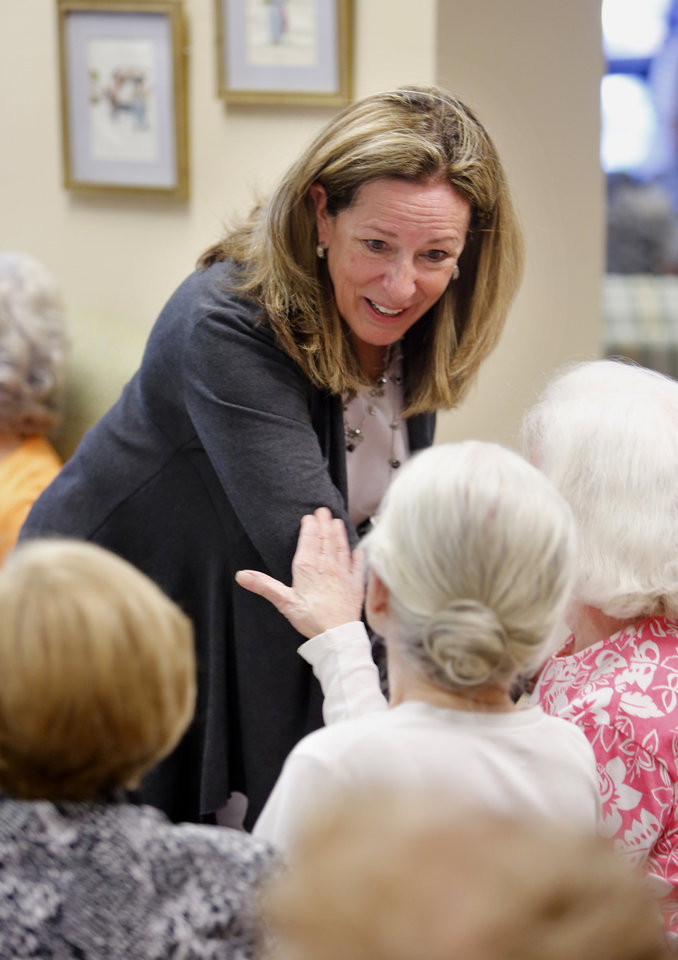 Photo - 1st Congressional District Democratic candidate Elizabeth Colbert Busch smiles while meeting senior citizen voters at The Canterbury House Monday, May 6, 2013, in Charleston S.C.  Colbert Busch is making her last campaign push against her Republican opponent, Mark Sanford, before election day on Tuesday. May 7. The two are running in a special election for the state's vacant 1st District congressional seat. (AP Photo/Mic Smith)