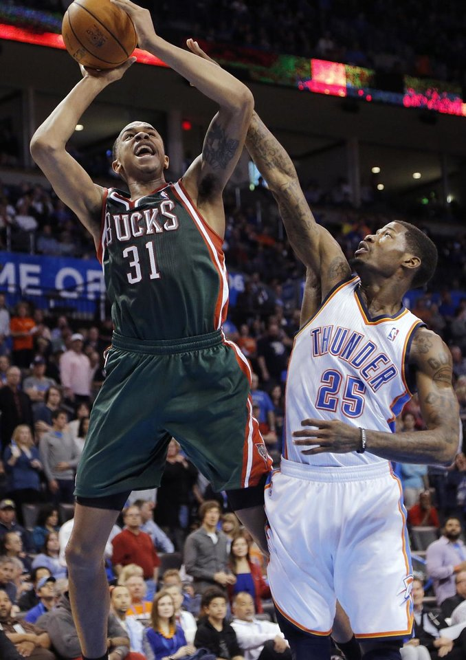 Oklahoma City's DeAndre Liggins (25) defends on Milwaukee 's John Henson (31) during the season finally NBA basketball game between the Oklahoma City Thunder and the Milwaukee Bucks at Chesapeake Energy Arena on Wednesday, April 17, 2013, in Oklahoma City, Okla.   Photo by Chris Landsberger, The Oklahoman