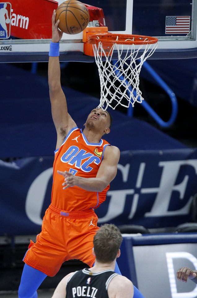 Photo - Oklahoma City's Darius Bazley (7) goes to the basket during an NBA basketball game between the Oklahoma City Thunder and the San Antonio Spurs at Chesapeake Energy Arena in Oklahoma City, Tuesday, Jan. 12, 2021. [Bryan Terry/The Oklahoman]