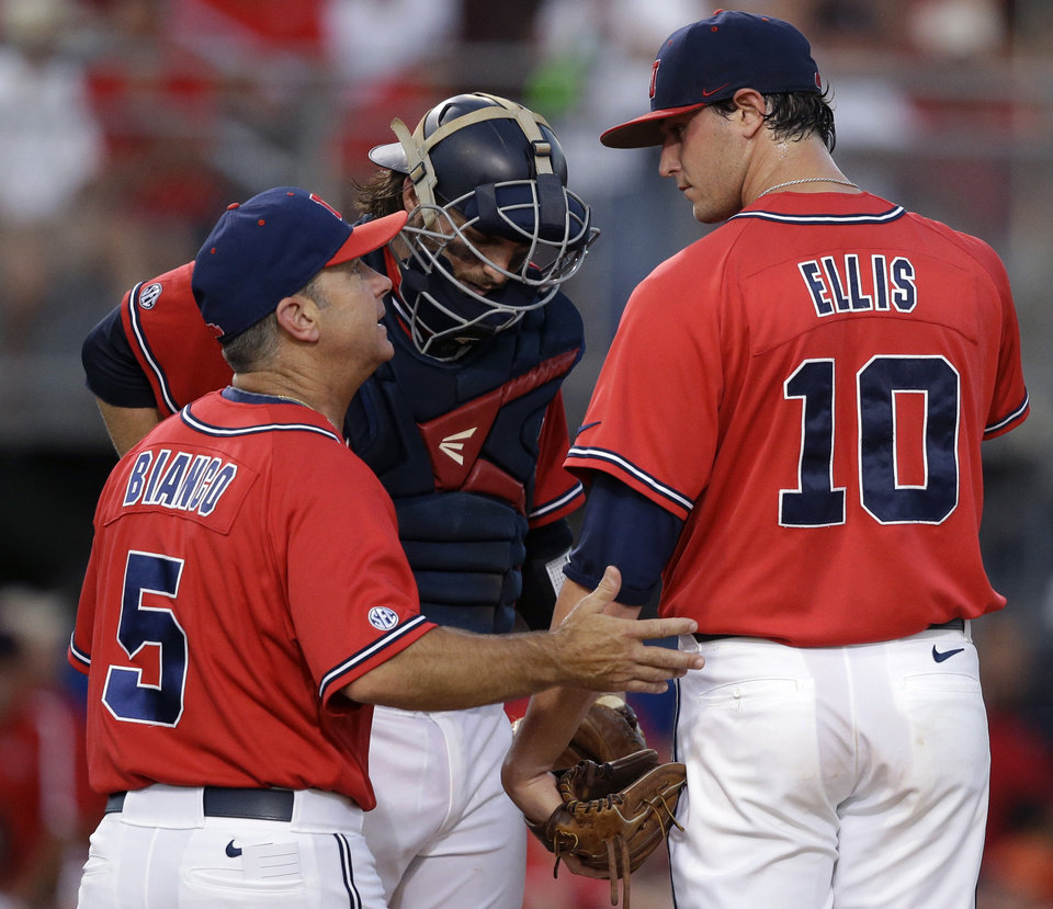 Photo - Mississippi head coach Mike Bianco (5) talks to pitcher Chris Ellis (10) in the third inning of an NCAA college baseball tournament super regional game against Louisiana Lafayette in Lafayette, La.,Saturday, June 7, 2014. (AP Photo/Gerald Herbert)