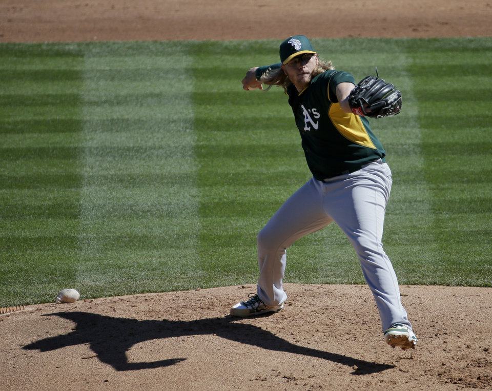 Photo - Oakland Athletics starting pitcher A.J. Griffin throws against the Colorado Rockies during the second inning of a spring training baseball game in Scottsdale, Ariz., Saturday, March 8, 2014. (AP Photo/Chris Carlson)
