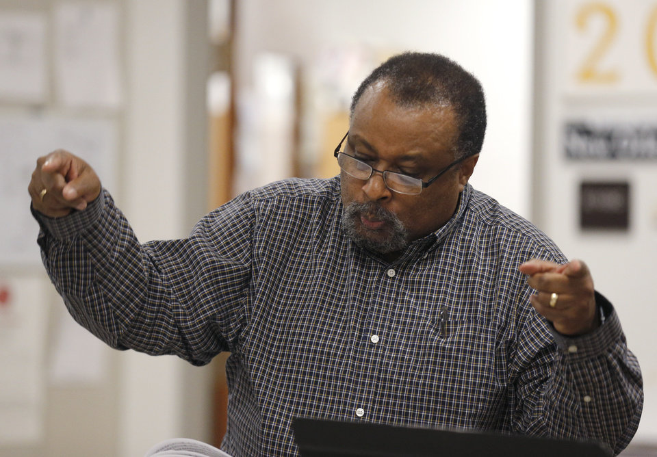 Photo -  Reginald Irons directs during jazz band at Classen School of Advanced Studies. [Photo by Sarah Phipps, The Oklahoman]