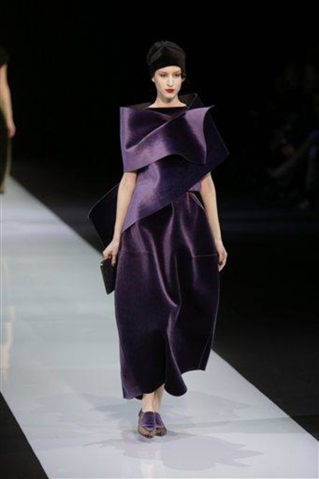 Photo - A model wears a creation for Emporio Armani women's Fall-Winter 2013-14 collection, part of the Milan Fashion Week, unveiled in Milan, Italy, Sunday, Feb. 24, 2013. (AP Photo/Luca Bruno)