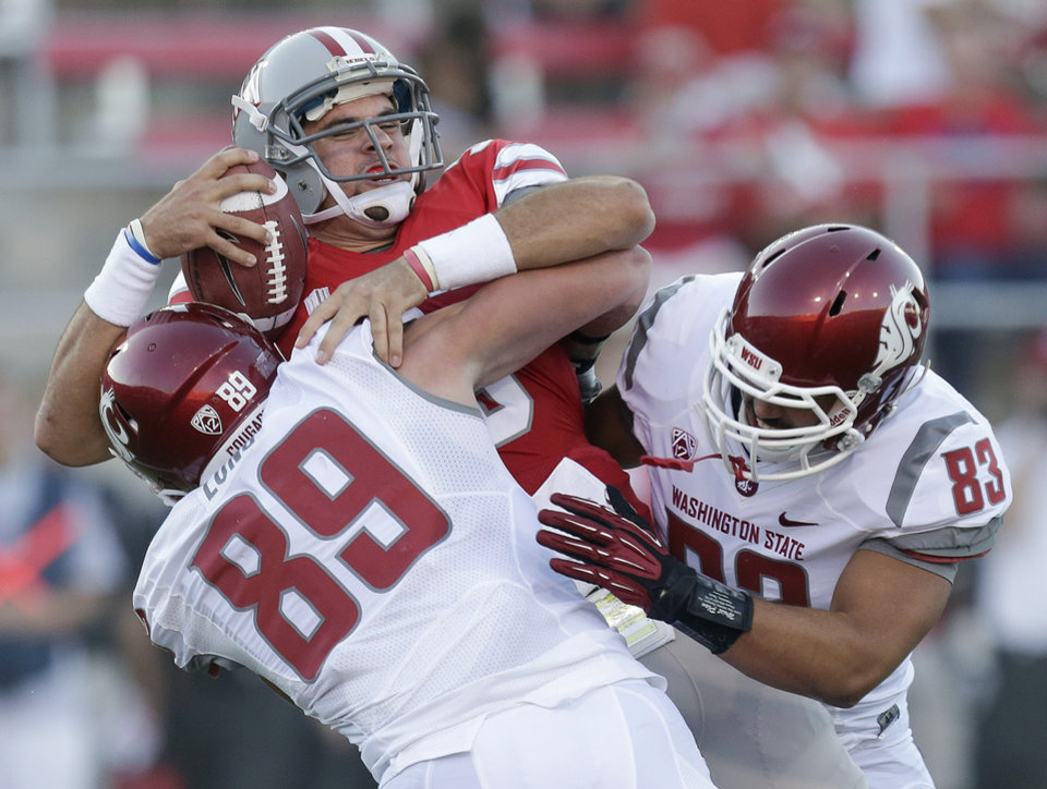 Photo -   UNLV quarterback Nick Sherry is sacked by Washington State linebackers Travis Long (89) and Logan Mayes (83) during the first quarter of an NCAA college football game, Friday, Sept. 14, 2012, in Las Vegas. (AP Photo/Julie Jacobson)