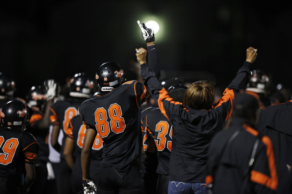 Photo - Douglass players cheer from the sidelines during a high school football game between Douglass and Ada at Moses F. Miller Stadium in Oklahoma City, Friday, Nov. 2, 2012.  Photo by Garett Fisbeck, The Oklahoman