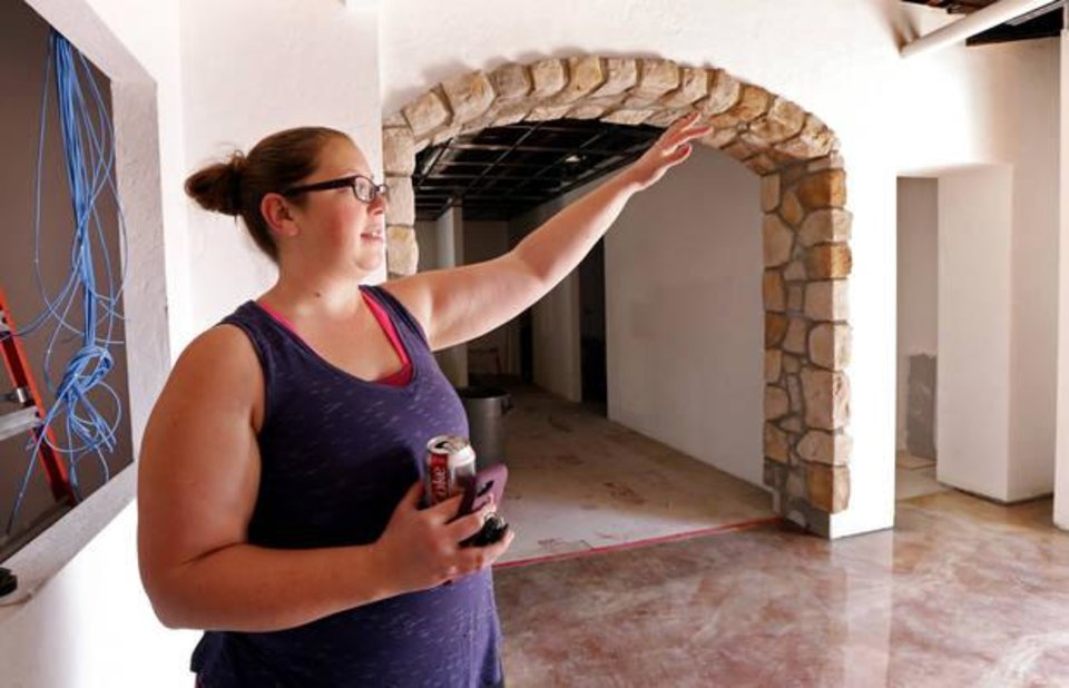 Photo -  Jennifer Dennis, owner, shows details of the overhauled Othello's Italian Restaurant in Norman, which reopened last week. [Photo by Steve Sisney, The Oklahoman]