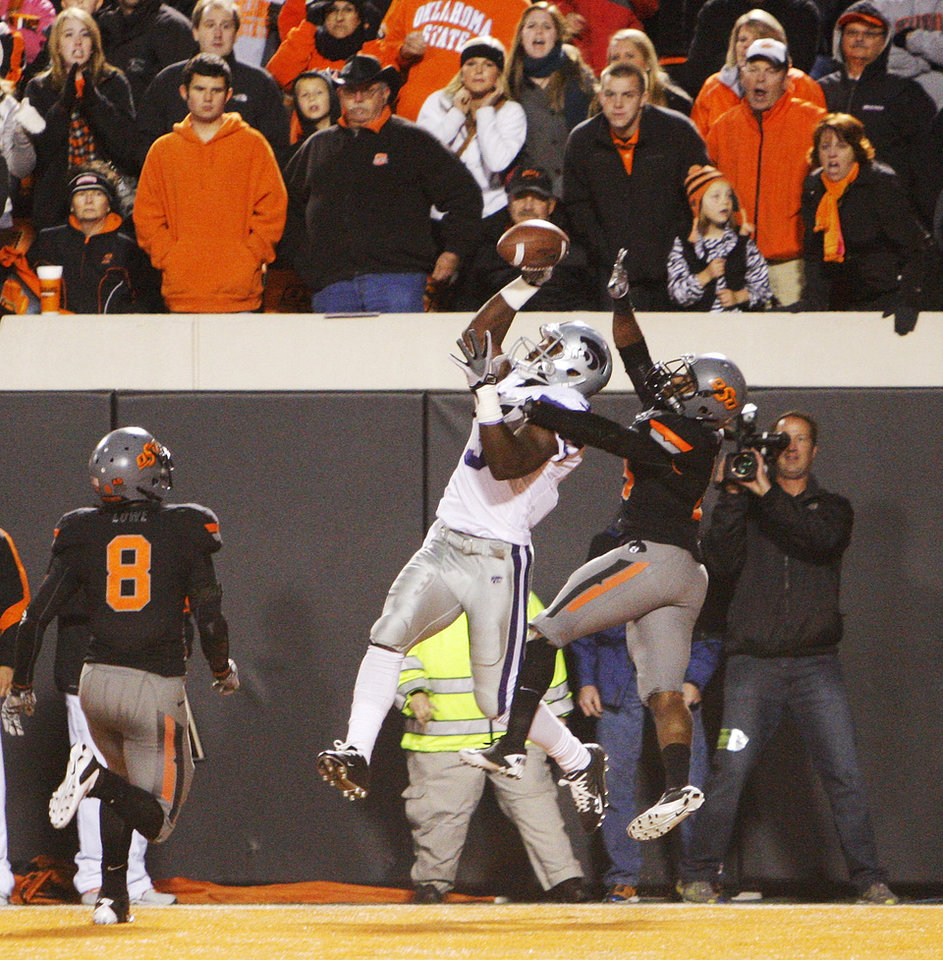Photo - OSU's Brodrick Brown (19) breaks up a pass intended for Chris Harper (3) of KSU as Daytawion Lowe (8) of OSU watches on the second-to-last play of the game in the fourth quarter during a college football game between the Oklahoma State University Cowboys (OSU) and the Kansas State University Wildcats (KSU) at Boone Pickens Stadium in Stillwater, Okla., Saturday, Nov. 5, 2011. OSU won, 52-45. Photo by Nate Billings, The Oklahoman
