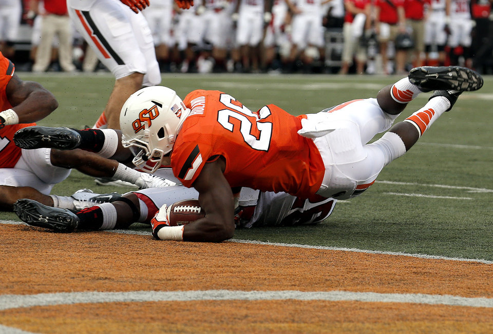 Photo - Oklahoma State's Desmond Roland (26) scores a touchdown during a college football game between the Oklahoma State University Cowboys (OSU) and the Lamar University Cardinals at Boone Pickens Stadium in Stillwater, Okla., Saturday, Sept. 14, 2013. Photo by Sarah Phipps, The Oklahoman