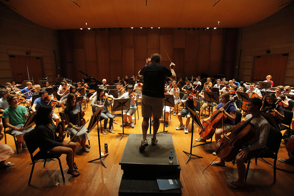 Director Jeffrey Grogan leads the orchestra in a rehearsal at Quartz Mountain Oklahoma Summer Arts Institute in Lone Wolf, Thursday, June 14, 2012.  Photo by Garett Fisbeck, The Oklahoman