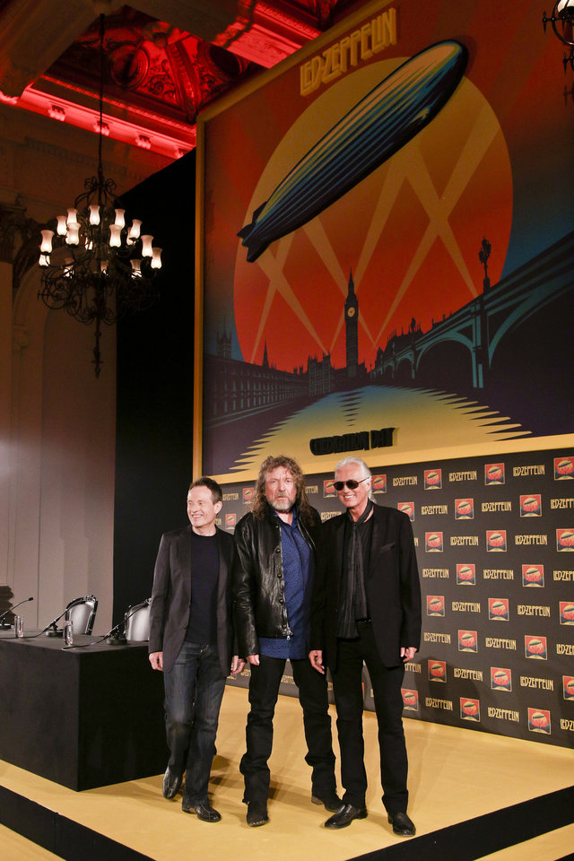 Photo -   Bassist and keyboardist John Paul Jones, from left, frontman Robert Plant and guitarist Jimmy Page pose for photos at a media screening ahead of the worldwide theatrical release of Led Zeppelin's 2007 Celebration Day concert at the O2, on Friday, Sept. 21, 2012 in London. (Photo by Miles Willis/Invision/AP)