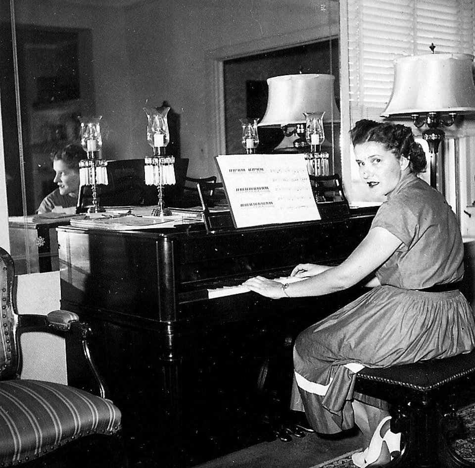 Del Rose Sieber plays piano in the sixth floor apartment that was her family's home. photo Provided  by Marva Ellard