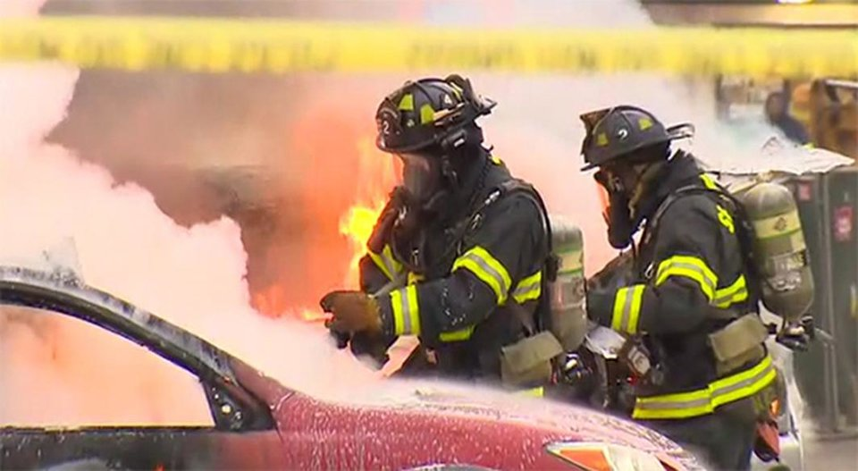 Photo - In this image made from video provided by KOMO-TV, emergency crews respond to the scene of a news helicopter crash outside the KOMO-TV studios near the space needle in Seattle, Tuesday, March 18, 2014, in Seattle. The station says the copter was apparently coming in for a landing on its rooftop Tuesday morning when it possibly hit the side of the building and went down, hitting several vehicles. (AP Photo/Courtesy KOMO-TV) MANDATORY CREDIT