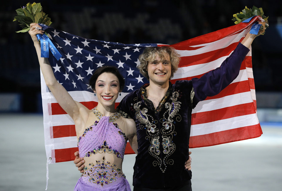 Photo - Meryl Davis and Charlie White of the United States pose for photographers after placing first in the ice dance free dance figure skating finals at the Iceberg Skating Palace during the 2014 Winter Olympics, Monday, Feb. 17, 2014, in Sochi, Russia. (AP Photo/Vadim Ghirda)