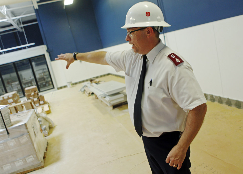 Photo - Capt.Carlyle Gargis, commander of The Salvation Army Central Oklahoma Area Command, shows off a nearly finished room at the new Salvation Army Chesapeake Energy Center of Hope under construction at 1001 N Pennsylvania Ave.  Photo by K.T. King, The Oklahoman  KT King -