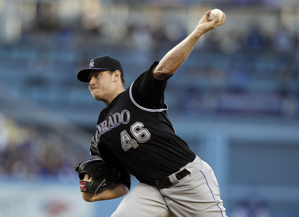 Photo - Colorado Rockies starting pitcher Tyler Matzek throws against the Los Angeles Dodgers in the first inning of a baseball game on Monday, June 16, 2014, in Los Angeles.   (AP Photo/Alex Gallardo)