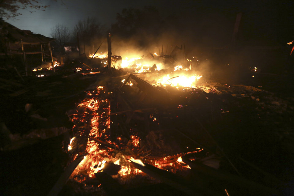 Photo - The remains of a home burn early Thursday morning, April 18, 2013, after a fertilizer plant exploded Wednesday night in West, Texas. The massive explosion killed as many as 15 people and injured more than 160, shaking the ground with the strength of a small earthquake and leveling homes and businesses for blocks in every direction. (AP Photo/LM Otero)
