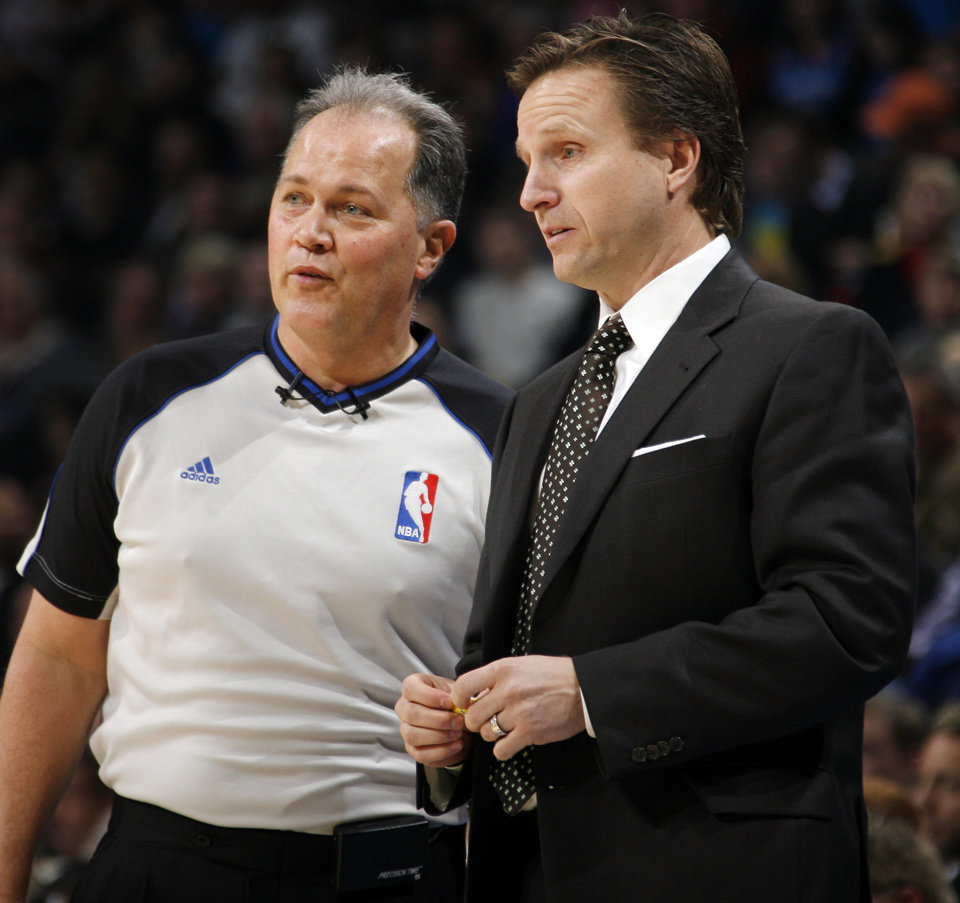 Oklahoma City head coach Scott Brooks, right, talks with official Mark Wunderlich during the NBA basketball game between the Atlanta Hawks and the Oklahoma City Thunder at the Ford Center in Oklahoma City, Tuesday, February 2, 2010. Photo by Nate Billings, The Oklahoman