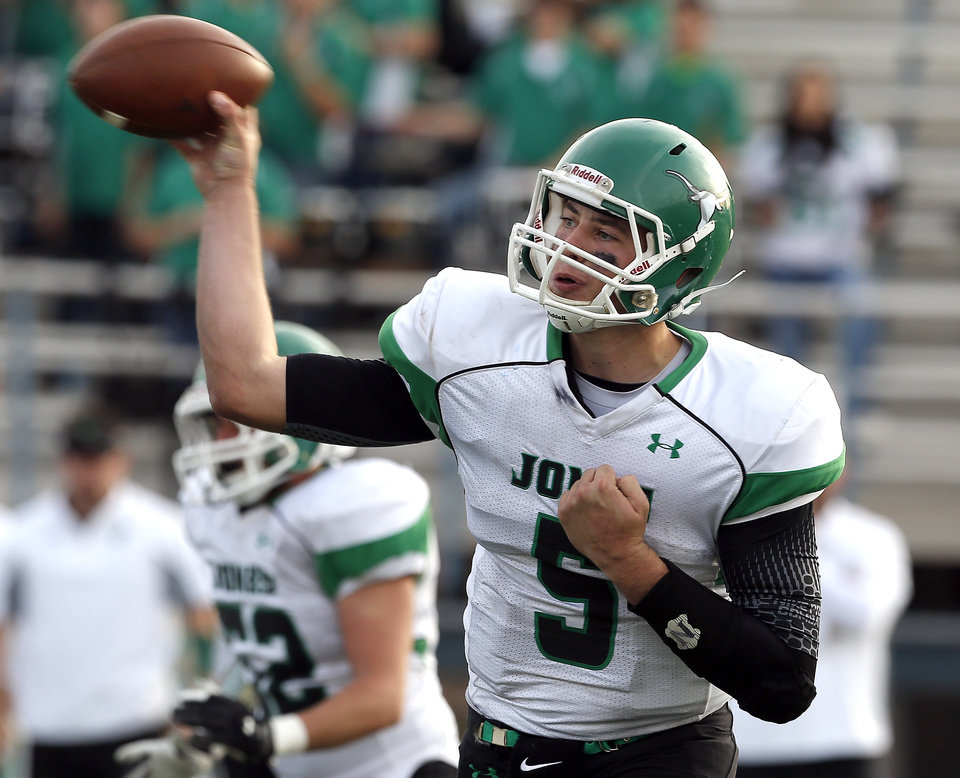 HIGH SCHOOL FOOTBALL PLAYOFFS: Jones\' David Cornwell throws a pass during the high school playoff game between Jones and Blanchard at Putnam City High School, Saturday,Dec. 1, 2012. Photo by Sarah Phipps, The Oklahoman