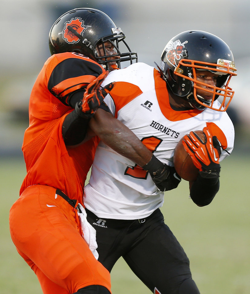 Photo - Carlos Hishaw of Douglass brings down  Booker T. Washington's Deonta Owens during their high school football game at Douglass in Oklahoma City, Friday, September 6, 2013. Photo by Bryan Terry, The Oklahoman