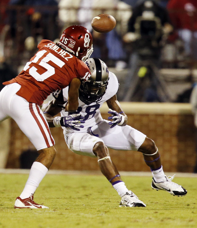 Photo - Oklahoma's Zack Sanchez (15) breaks up a pass intended for TCU's Cam White during the second half of a college football game between the University of Oklahoma Sooners (OU) and the TCU Horned Frogs at Gaylord Family-Oklahoma Memorial Stadium in Norman, Okla., on Saturday, Oct. 5, 2013. Photo by Steve Sisney, The Oklahoman