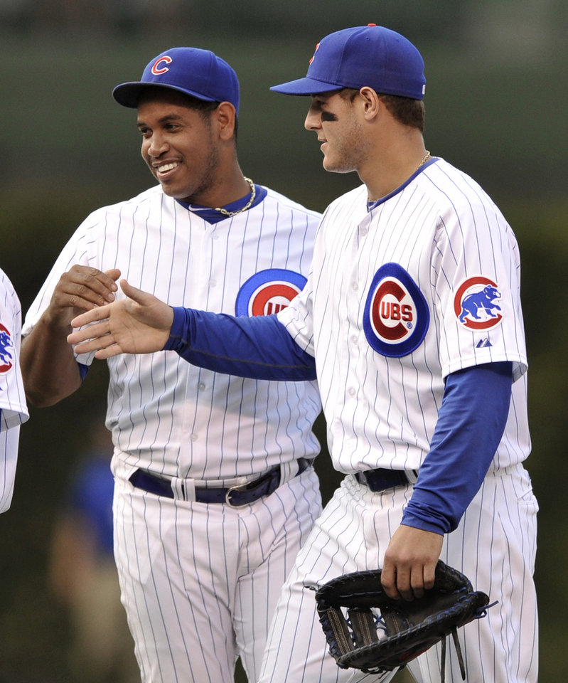 Photo -   Chicago closing pitcher Carlos Marmol left, celebrates with teammate Anthony Rizzo right, after defeating the Pittsburgh Pirates 13-9 in a baseball game in Chicago, Sunday, Sept. 16, 2012. (AP Photo/Paul Beaty)