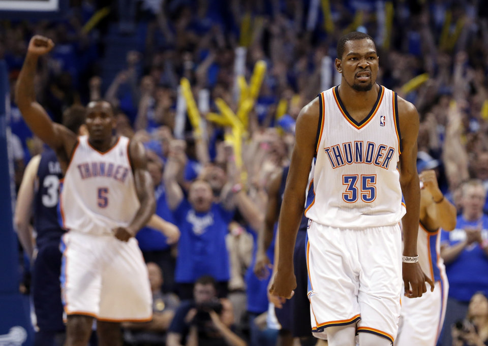 Photo - Oklahoma City's Kevin Durant (35) celebrates his go ahead shot in the finals seconds of Game 1 in the second round of the NBA playoffs between the Oklahoma City Thunder and the Memphis Grizzlies at Chesapeake Energy Arena in Oklahoma City, Sunday, May 5, 2013. Photo by Sarah Phipps, The Oklahoman