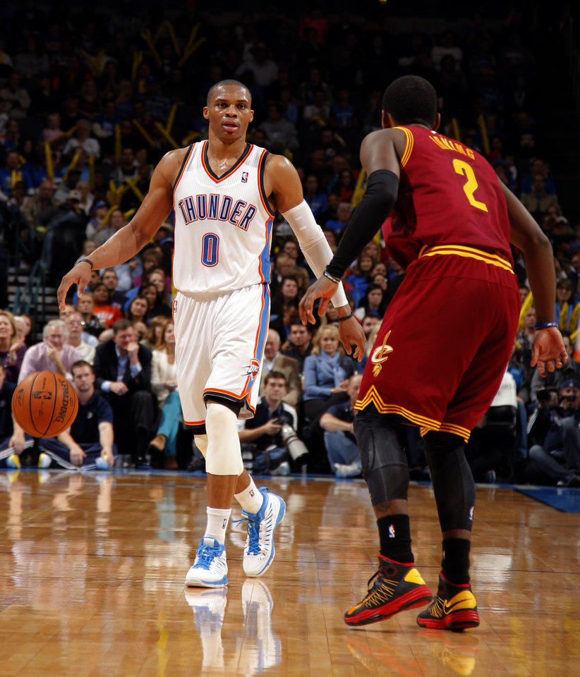 Oklahoma City's Russell Westbrook (0) dribbles up court as Cleveland's Kyrie Irving (2) defends during the NBA basketball game between the Oklahoma City Thunder and the Cleveland Cavaliers at the Chesapeake Energy Arena, Sunday, Nov. 11, 2012. Photo by Sarah Phipps, The Oklahoman