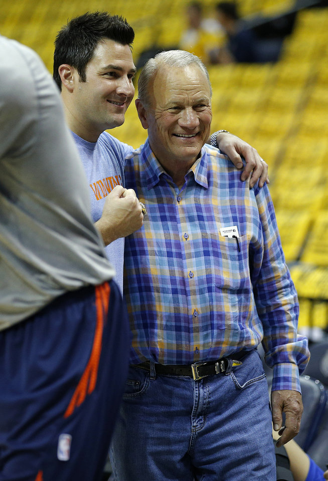 Photo - Barry Switzer poses for a photo with Oklahoma City fan Kyle McElvaney before Game 4 in the first round of the NBA playoffs between the Oklahoma City Thunder and the Memphis Grizzlies at FedExForum in Memphis, Tenn., Saturday, April 26, 2014. Photo by Bryan Terry, The Oklahoman