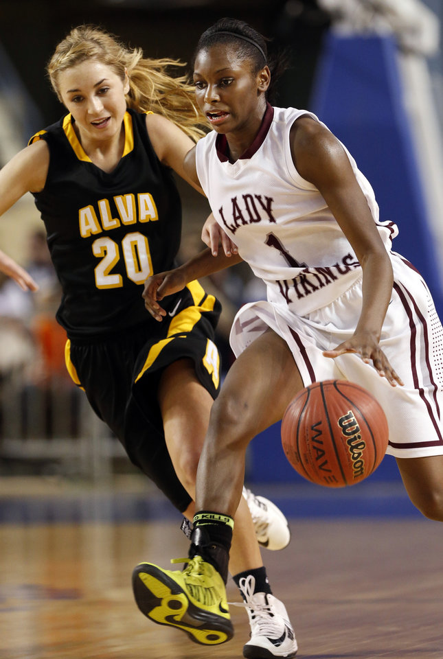 Northeast's Lanesia Williams drives past Alva's Jayna Hadwiger during the 2A girls championship game where the Northeast Academy Lady Vikings defeated the Alva high school Lady Bugs 53-36 at the State Fair Arena on Saturday, March 9, 2013 in Oklahoma City, Okla.  Photo by Steve Sisney, The Oklahoman