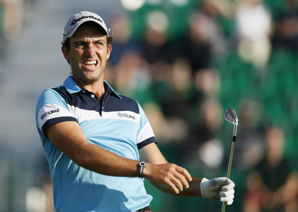 Photo - Edoardo Molinari of Italy watches his shot off the 4th tee during the first day of the British Open Golf championship at the Royal Liverpool golf club, Hoylake, England, Thursday July 17, 2014. (AP Photo/Alastair Grant)