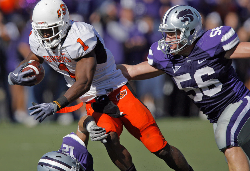 Oklahoma State's Joseph Randle (1) gets past Kansas State's Alex Hrebec (56) during the second half of the college football game between the Oklahoma State University Cowboys (OSU) and the Kansas State University Wildcats (KSU) on Saturday, Oct. 30, 2010, in Manhattan, Kan.   Photo by Chris Landsberger, The Oklahoman