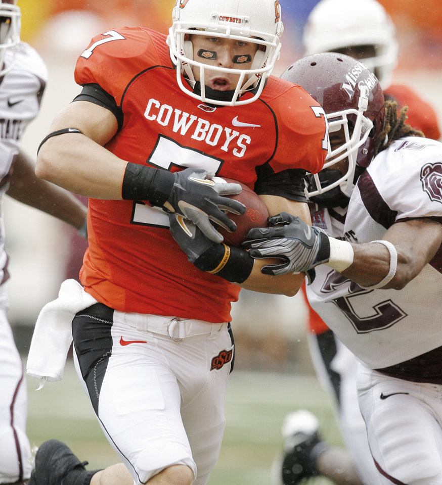 Photo - Bo Bowling protects the ball as he's hit by Chris Farrar at the end of his TD catch/run at the Oklahoma State University (OSU) football game against Missouri State University (MSU) Saturday Sept. 13, 2008 at Boone Pickens Stadium in Stillwater, Okla. BY MATT STRASEN, THE OKLAHOMAN.