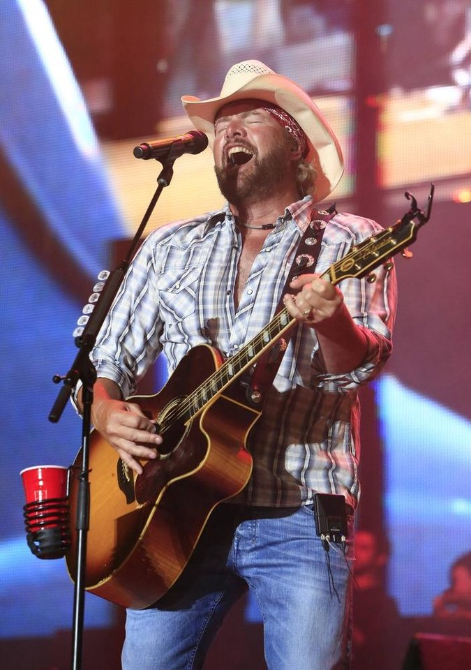 Toby Keith performs at the Oklahoma Twister Relief Concert at the Gaylord Family-Oklahoma Memorial Stadium on Saturday, July 6, 2013 in Norman, Okla. (Photo by Alonzo Adams/Invision/AP)