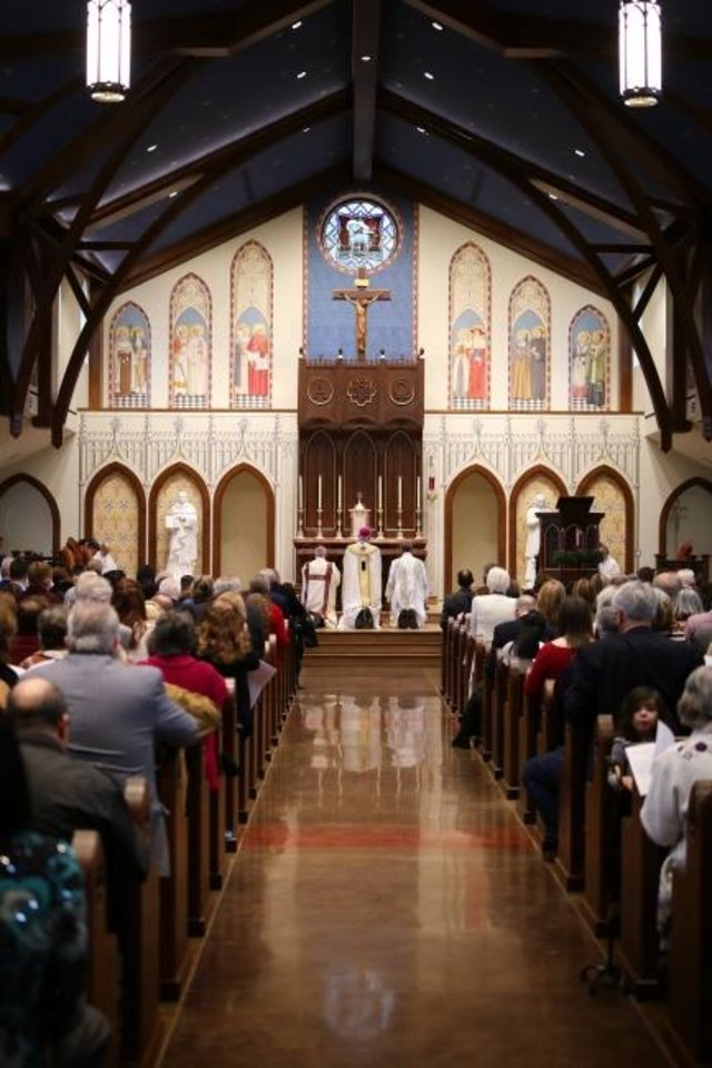 Photo -  A crowd gathers for the dedication ceremony of the church and altar at St. Thomas More University Parish and Student Center on the OU campus in Norman. [Doug Hoke/The Oklahoman]