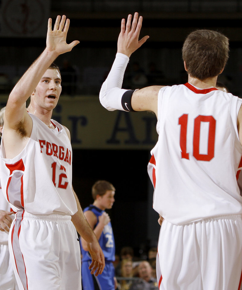 Photo - Forgan's Ryan Radcliff, left, celebrates with Jake Regier during the semifinal game of the Class B boys state basketball tournament at State Fair Arena in Oklahoma CIty, Friday, March 3, 2012. Photo by Bryan Terry, The Oklahoman