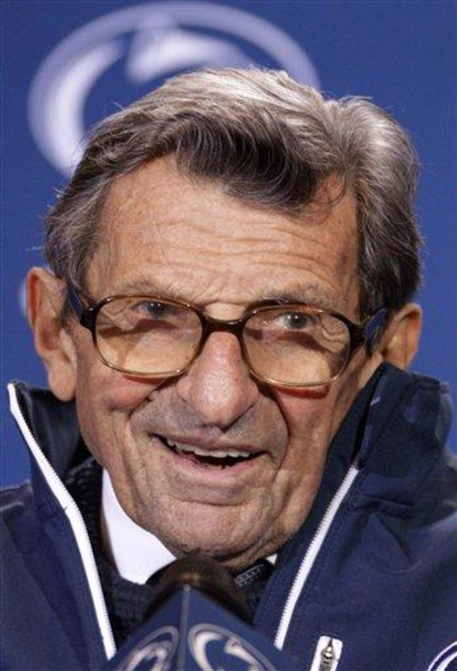Penn State head coach Joe Paterno talks with reporters after recording his 409th career win after defeating Illinois 10-7 in an NCAA college football game in State College, Pa., Saturday, Oct. 29, 2011. (AP Photo/Gene J. Puskar)