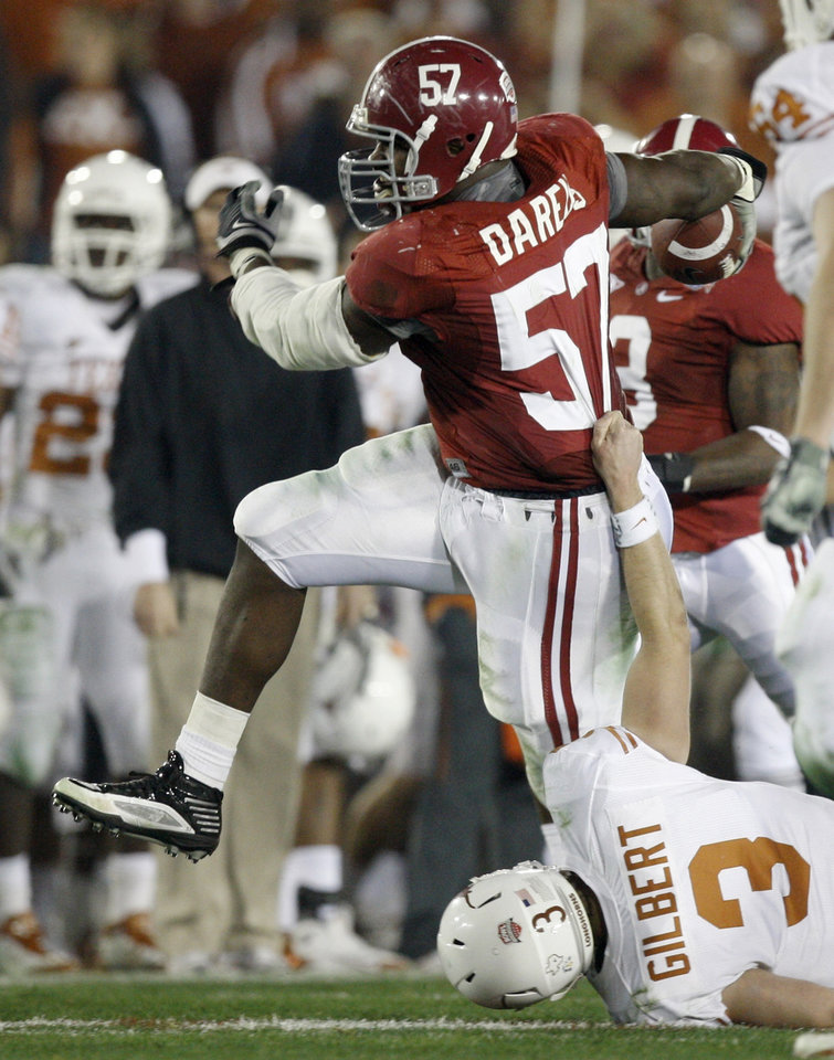 University of Alabama defensive lineman Marcell Dareus (57) breaks away from Texas quarterback Garrett Gilbert (3) after intercepting a pass from Gilbert during the second quarter of the BCS Championship NCAA college football game in Pasadena, Calif., Thursday, Jan. 7, 2010. Dareus went on to score a touchdown on the play. (AP Photo/Chris Carlson)